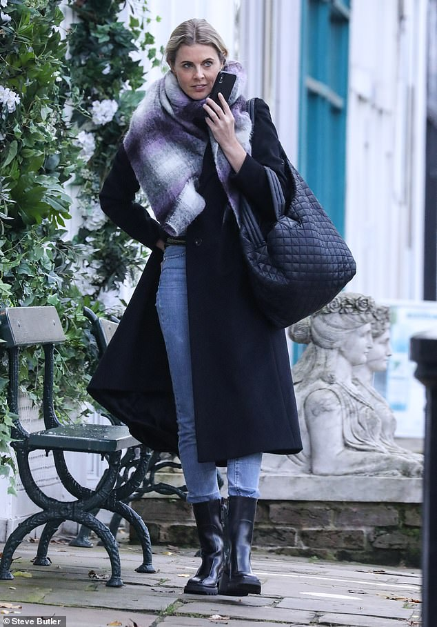 Chilly:The blonde stylishly bundled up from the crisp autumnal weather in an oversized purple and grey scarf as she kept one hand tucked in her pocket