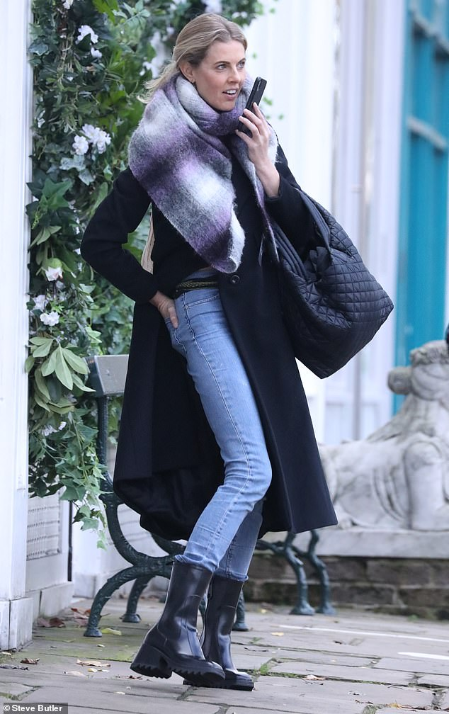 Errands:The actress, 41, looked effortlessly chic in an understated knee-length black jacket as she ran errands ahead of the looming national lockdown