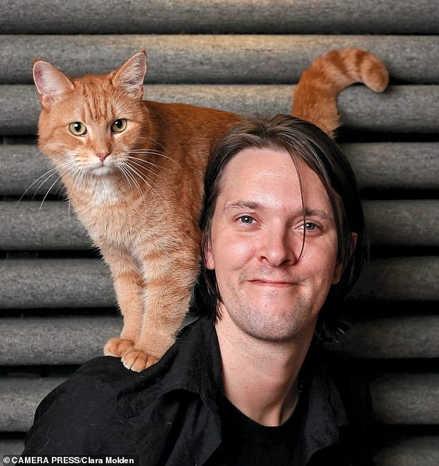 James Bowen (pictured) discovered Bob the cat (pictured) injured in the hallway of his sheltered accommodation