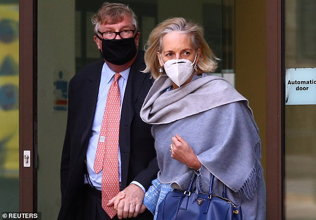 Britain's Crispin Odey and his wife Nichola Pease leave Westminster Magistrates Court after he plead not guilty to charges of sexually assaulting a banker in 1998