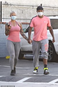 Amber Rose and her babydaddy Alexander 'A.E.' Edwards wear matching outfits for LA sushi date