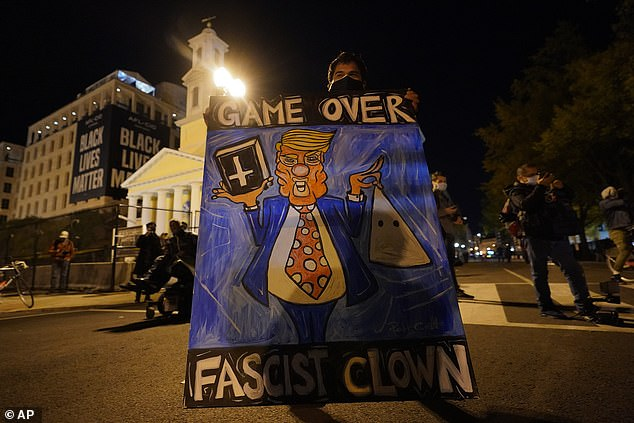 A demonstrator carries a topical sign mocking Donald Trump in Washington D.C.