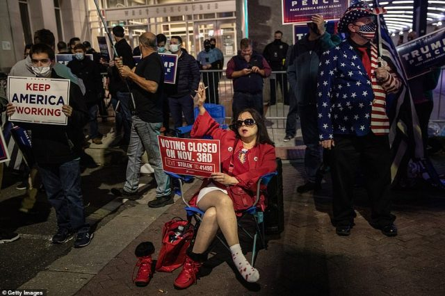 PENNSYLVANIA: Supporters of U.S. president Donald Trump hold signs and chant slogans during a protest outside the Philadelphia Convention center