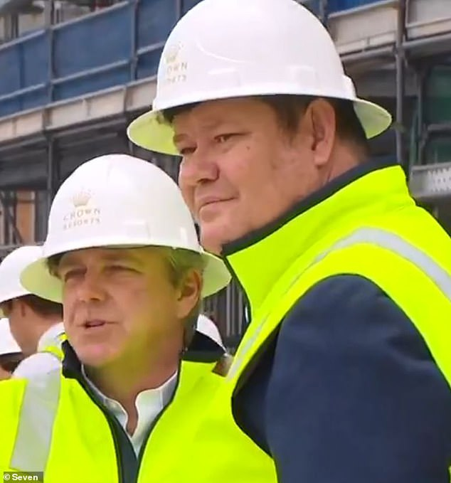 James Packer risks losing his licence to operate the Crown Sydney casino at Barangaroo on the harbourfront. The resort is due to open in December but an inquiry into Crown's suitability to operate a casino is ongoing. Packer is pictured inspecting the Crown Sydney site in January