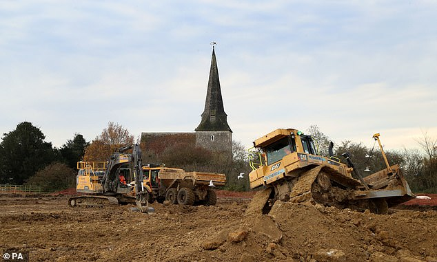 Work is underway to convert a 27-acre field into a post-Brexit lorry park, next to a 13th century church in the village of Sevington, Kent