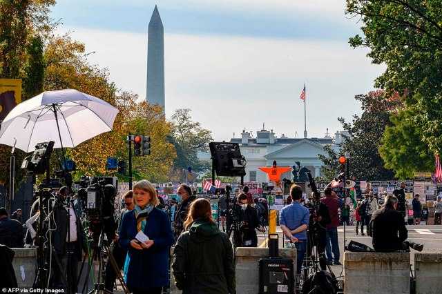 Journalists from all over the world wait for the result of the US Presidential elections on Black Lives Matter Plaza in front of the White House on November 6, 2020 in Washington