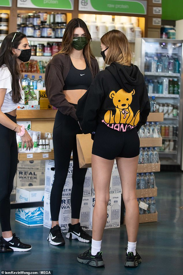 Fit:The leggy blonde showcased her toned stems in tiny black spandex shorts, adding white socks and sneakers