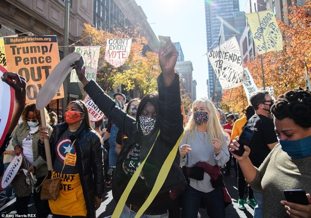 PHILADELPHIA:Protesters gather outside of the Pennsylvania Convention Center as Americans await election results in the 2020 Presidential Election on Thursday. Biden fans began to perform the 'YMCA' poking fun at Trump