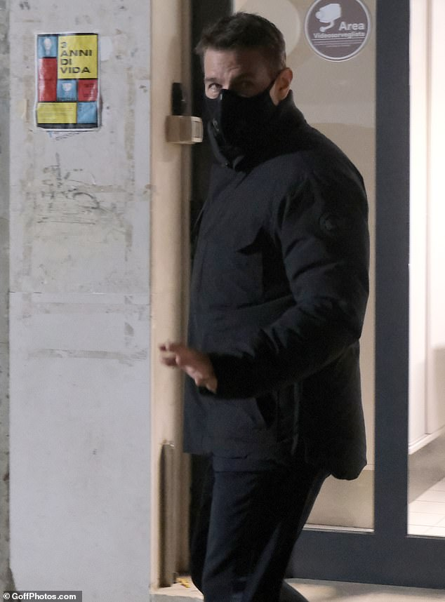 Out and about:The actor cut a laid-back figure as he donned a black face mask to head out into the Italian city