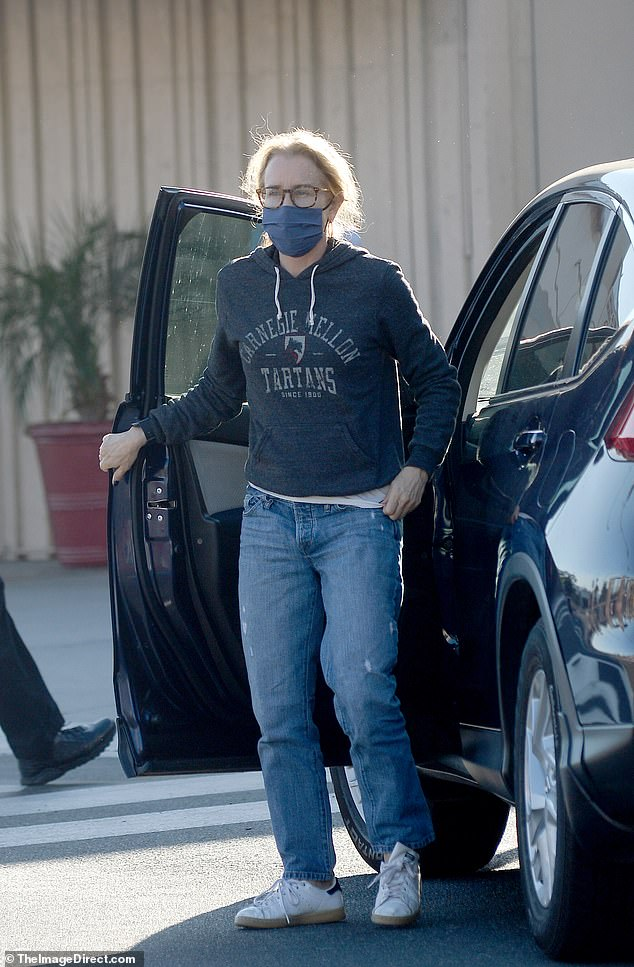 Proud mom: Felicity Huffman was spotted showing off her school spirit in a Carnegie Mellon University sweatshirt while dropping her daughter Sophia to the Burbank Airport on Wednesday - one year after she served time in prison for the college admissions scandal