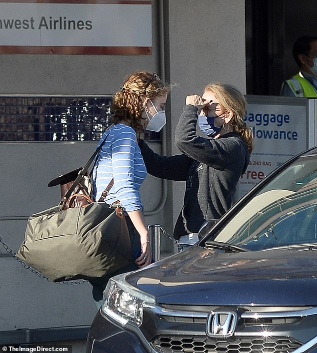Goodbyes:Felicity affectionately put one hand on her daughter's arm as they exchanged a few parting words before Sophia headed to make her flight