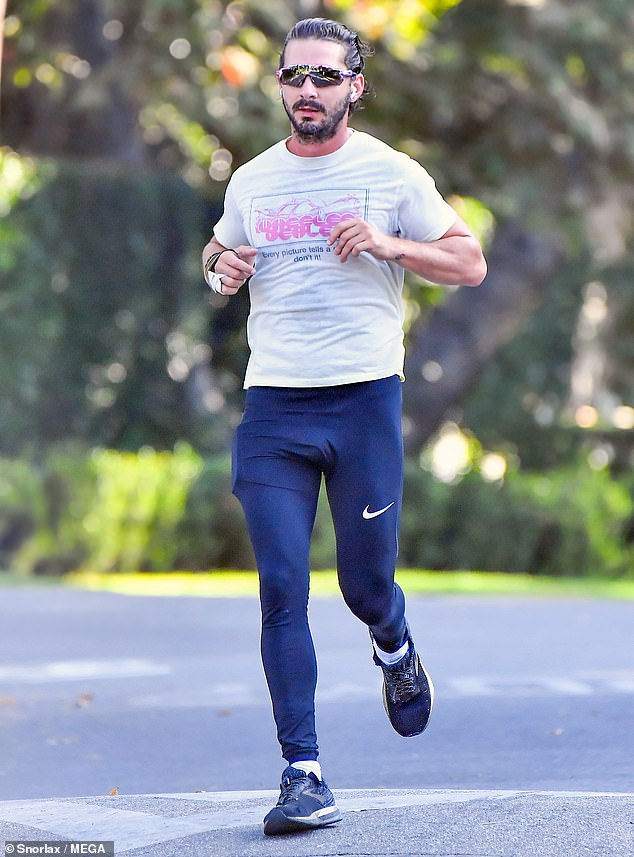 Push it to the limit! Shia LaBeouf was seen jogging with an arm brace on in Los Angeles on Friday