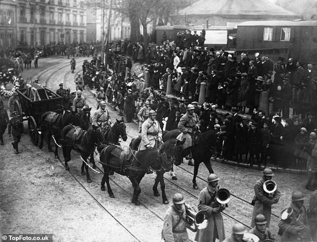 Thousands of people lined the streets as the remains were paraded, pictured here in Boulogne, France