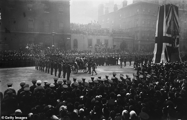 King George V lays a wreath on the coffin of the unknown soldier at the Cenotaph before the cortege went to Westminster Abbey where it was interred