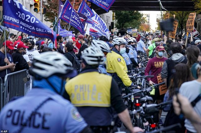 PHILADELPHIA:Police separate President Donald Trump supporters and pro-vote counting demonstrators outside the Philadelphia Convention Center three days after the presidential election polls closed as they await tabulation results