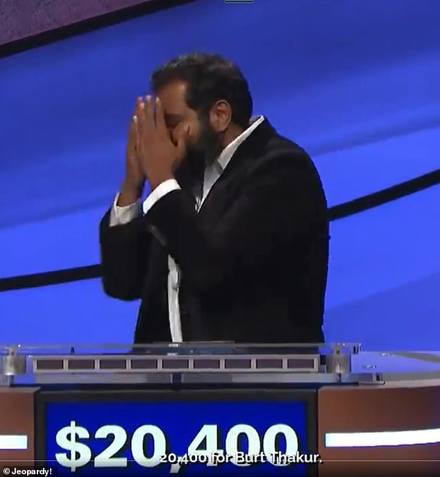 Burt Thakur (pictured) shed a few tears while speaking with Jeopardy! host Alex Trebek during Thursday night's episode