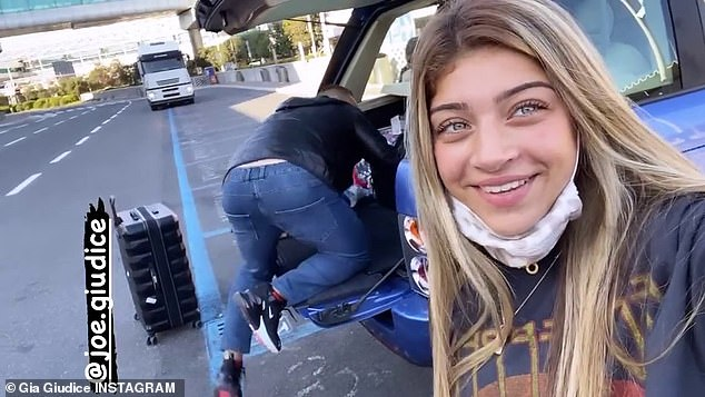 Good times: Gia shared a clip as their dad grabbed their luggage and put it in the car after they arrived to Rome