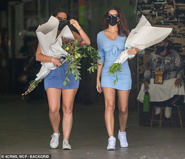 Flower power: While making selections, she chatted away with her pal, who also toted a number of bouquets, which Ratajkowski later showed off on her Instagram Story