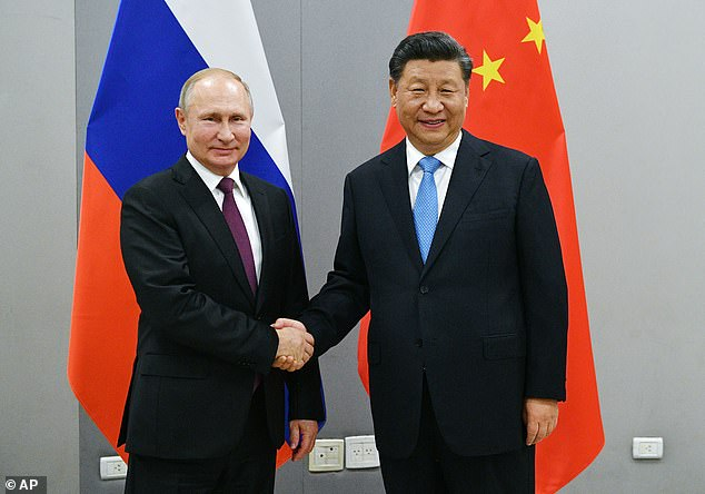 For the first time members of the House of Lords will have to declare any payments they receive from foreign governments or firms controlled by overseas states. Pictured: Putin andXi Jinping