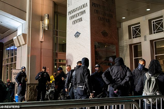 Philadelphia police officers gather outside the Pennsylvania Convention Center