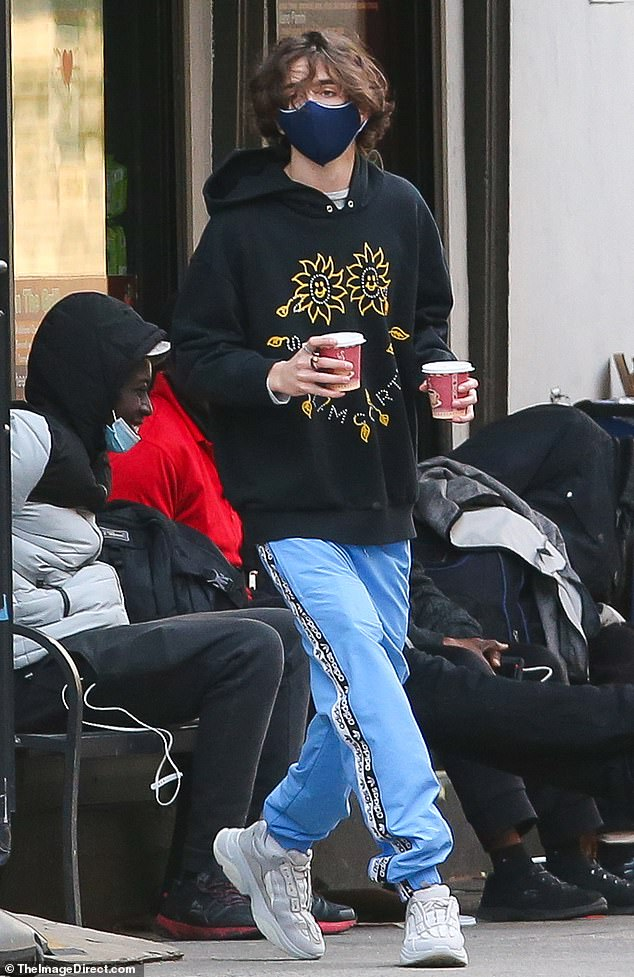 Caffeine blast: Timothée Chalamet, 24, was spotted stopping by a coffee shop and emerging with two drinks on Thursday in New York City
