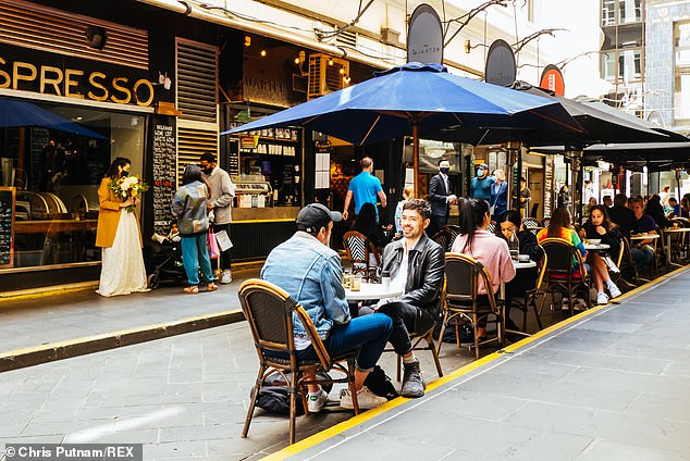 Crowds flock to cafes and retail shops inDegraves Lane in Melbourne after Stage Four lockdown was lifted (pictured on November 1)