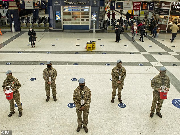132 Aviation Support Squadron selling poppies at Liverpool Street station, London