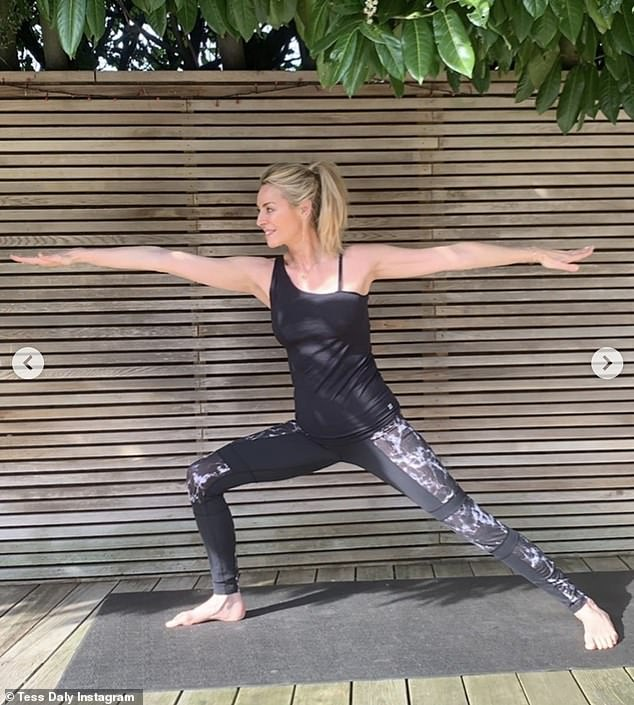 Keeping busy:The Strictly host, 51, revealed that she has loved heading out on country walks with her family, practicing her yoga moves and also taking some time to cuddle her dog