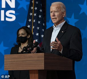 Joe Biden is pictured with his running mate Kamala Harris on Thursday