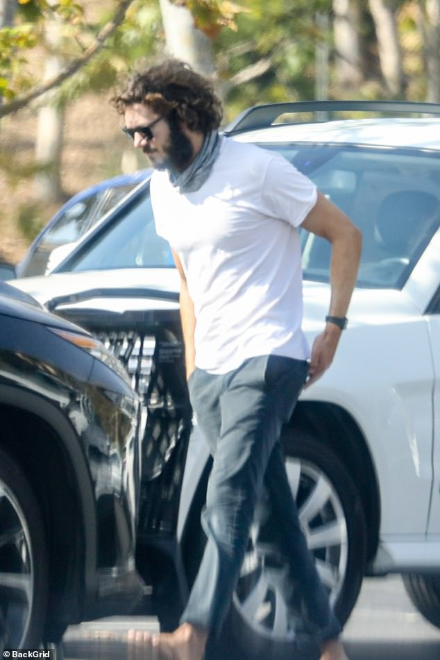 Keeping it casual: The actor stayed and looked cool in a white T-shirt and jeans