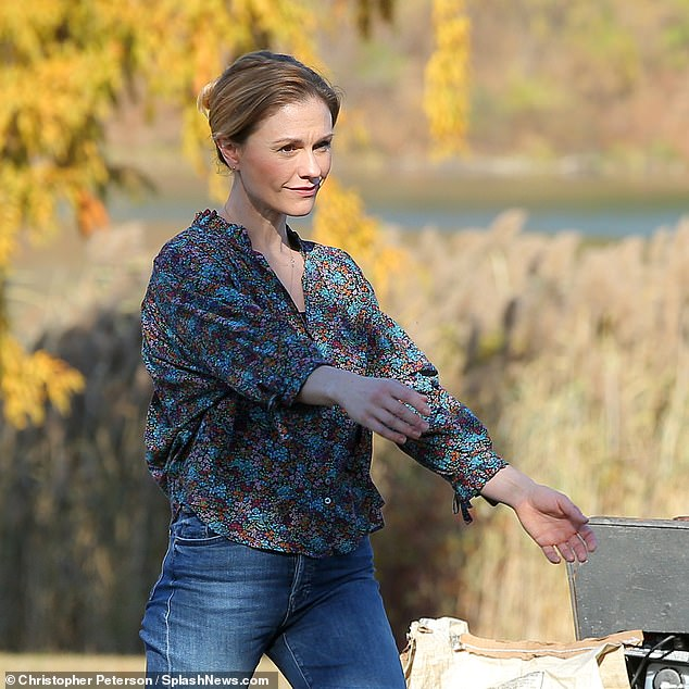 Floral:The True Blood actress sported a loose fitting brown and blue floral blouse that featured puffed sleeves and a ruffled collar