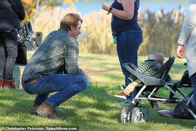 Man-to-man:He even knelt down at one point so that he could be eye-level with baby, who remained in a stroller in between takes