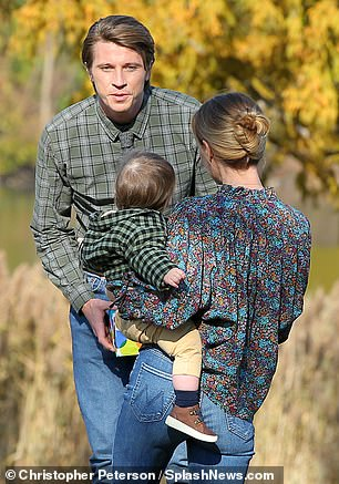 Taste of fatherhood: Garrett, who is expecting his first child with girlfriend Emma Roberts, 29, shared many precious moments with him and Anna's tiny co-star on Friday