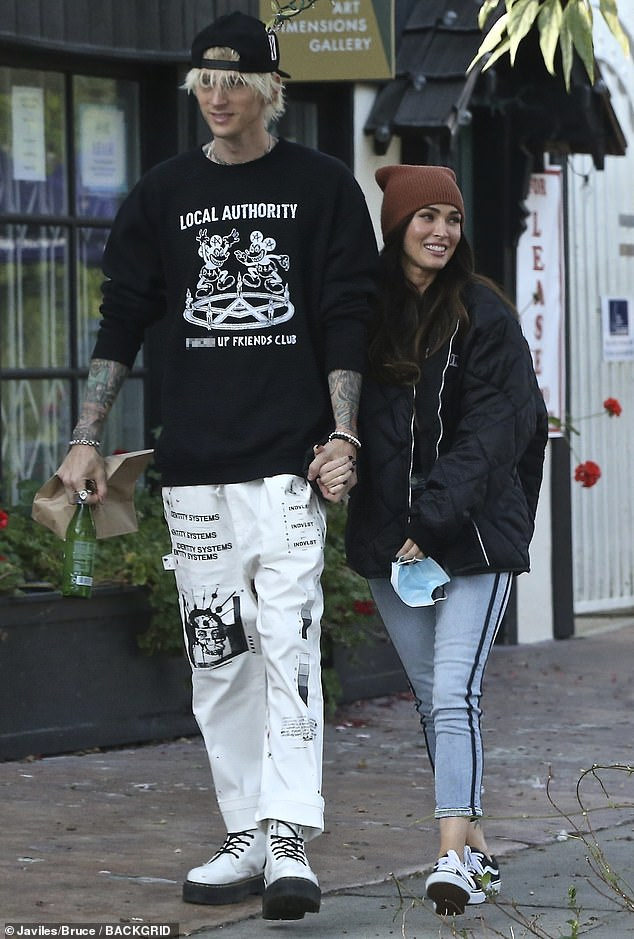 Romantic outing: Megan Foxwas all smiles Friday, as she bundled up in an oversized black quilted jacket for a romantic lunch outing with boyfriend Machine Gun Kelly in the Studio City neighborhood of Los Angeles