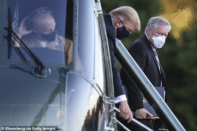 Meadows is pictured accompanying Trump to Walter Reed on October 2