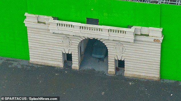 Set designers re-created the Palace gates, main entrance and inner courtyard on the Elstree lot, which are held up by scaffolding and surrounded by green screens