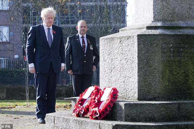 Prime Minister Boris Johnson (left), with Ian Ritchie from Hillingdon and District Royal British Legion, lay a wreath of remembrance at Uxbridge War Memorial in west London, ahead of Remembrance Sunday
