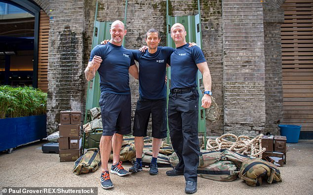 Pictured: Grylls (centre) with two BMF trainers. The companywill launch a new partnership with Army recruitment contractor Capita on Monday with the aim of making sure recruits are fit enough to begin the army's rigorous training programme