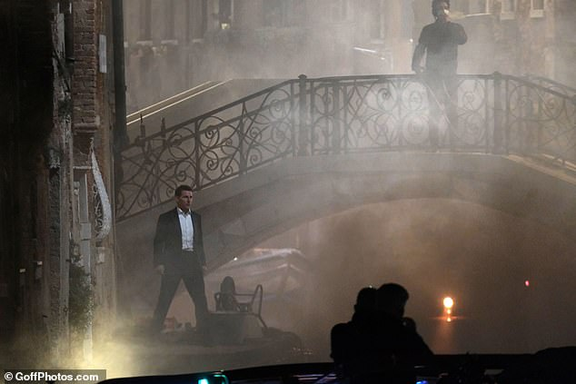 Filming: Tom looked ready for action as he filmed the atmospheric scenes