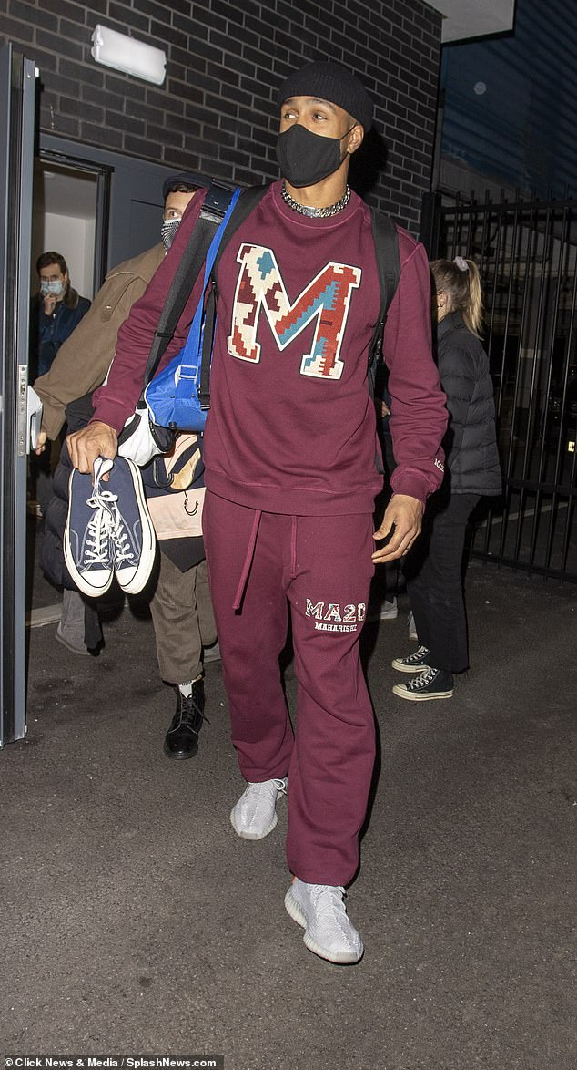 Dancer: Ashley Banjo, who helps choreograph the strip tease, donned a burgundy tracksuit