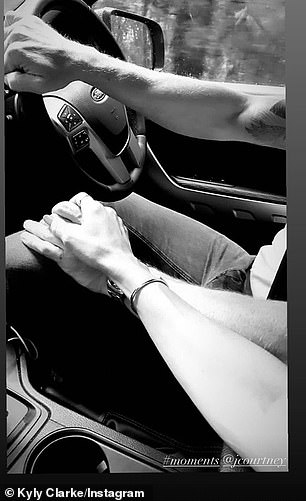 So sweet! Kyly Clarke shared a pictured of herself holding on to her boyfriend's James Courtney's hand as the pair enjoyed a drive together on Saturday