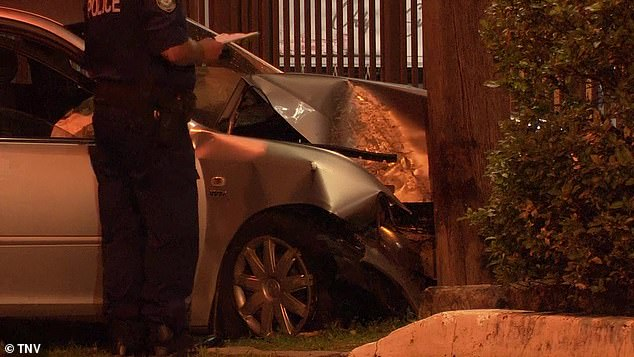 Four pedestrians have suffered injuries after a car allegedly lost control. Pictured: A smashed car at the scene