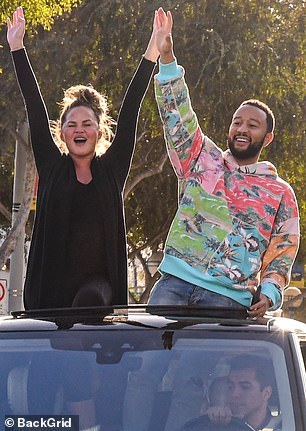 Grand Marshals: They served as unofficial Grand Marshals, standing through the sunroof of their car and waving to crowds