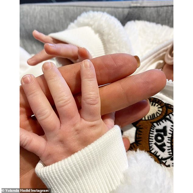 Privacy first: Hadid kept her little girl's privacy safe, as she tilted the image to not include her face, which she previously cut out or covered with GIFs in rare snaps