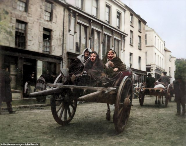 Three Irish women sit on a cart as they prepare to attend a funeral in County Kerry in 1899. Killarney, where this picture was taken, has a long history of religious settlements dating back to early medieval times. A ruined monastery founded in 640 on Innisfallen Island, which lies in one of the three Lakes of Killarney, remains a tourist attraction to this day. Killarney National Park is also home to a 16th-century castle stronghold which surrendered to Oliver Cromwell during the 17th-century wars