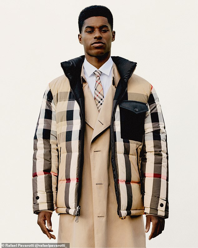Dapper:Marcus wowed in a padded jacket in the brand's iconic tartan print, which he wore over a sleek cream mac, another staple of the popular fashion house