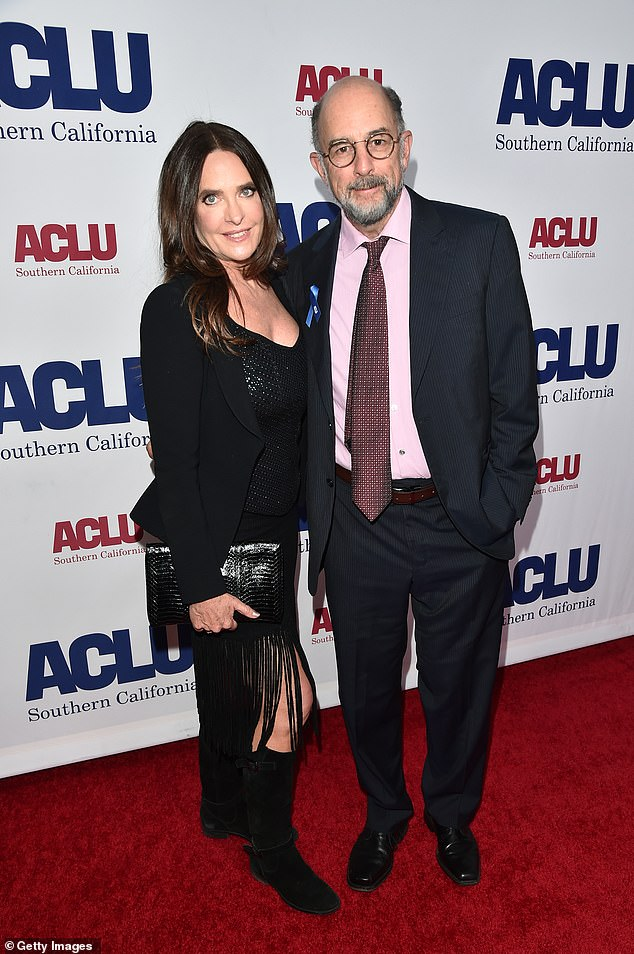 Sick together: The West Wing actor, 65, tweeted on Tuesday that he and his wife Sheila Kelley, 59, were sick with COVID-19;  seen here in november 2019