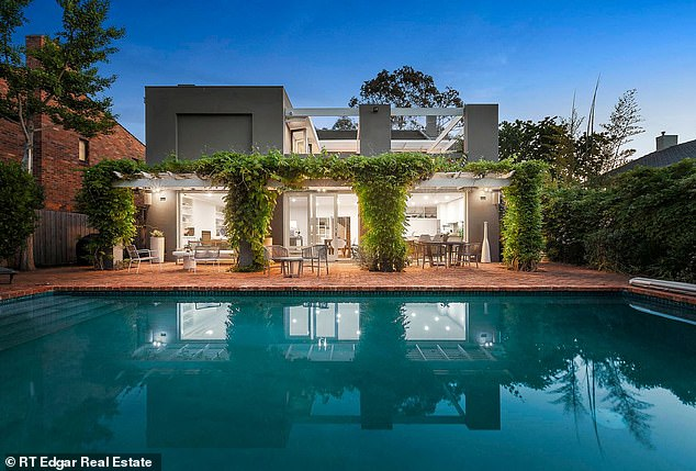 Outdoor living: The 838sqm property boasts a sunny backyard terrace with a large pool and lush gardens