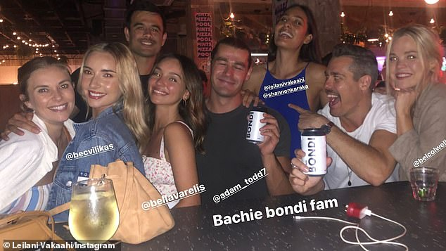 Just friends? Bella and Adam (both centre) appeared to be having a great time as they partied alongside several of their co-stars from The Bachelor franchise this month