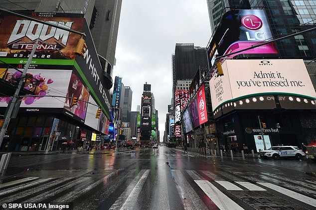Osterholm said Wednesday that a national lockdown may be the best way to keep hospitalizations and deaths down across the country until a vaccine can be distributed. A nearly empty Times Square pictured in March 2020 during New York City's first lockdown